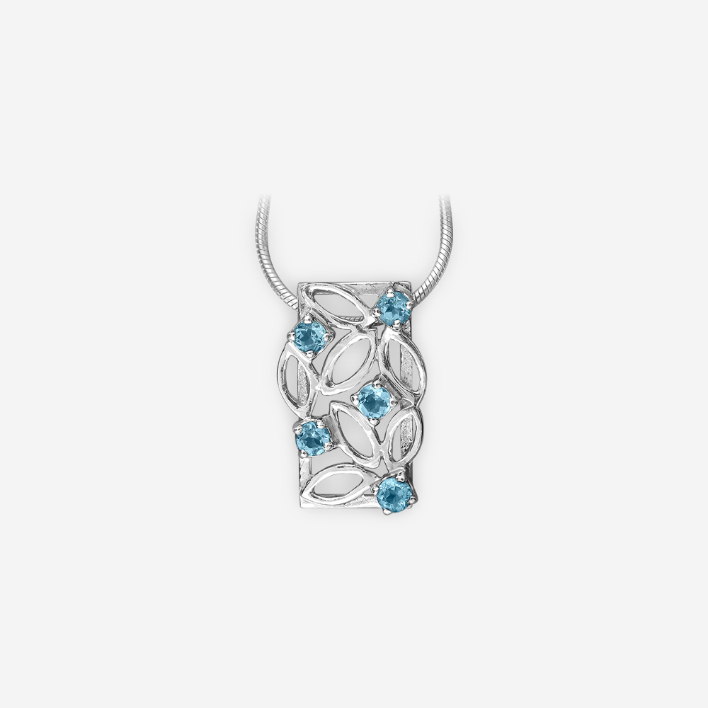 Small sterling silver blue topaz pendant with beautiful openwork design.