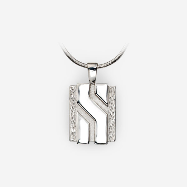 Small Unisex sterling silver pendant with contrasting textured and polished finishes.
