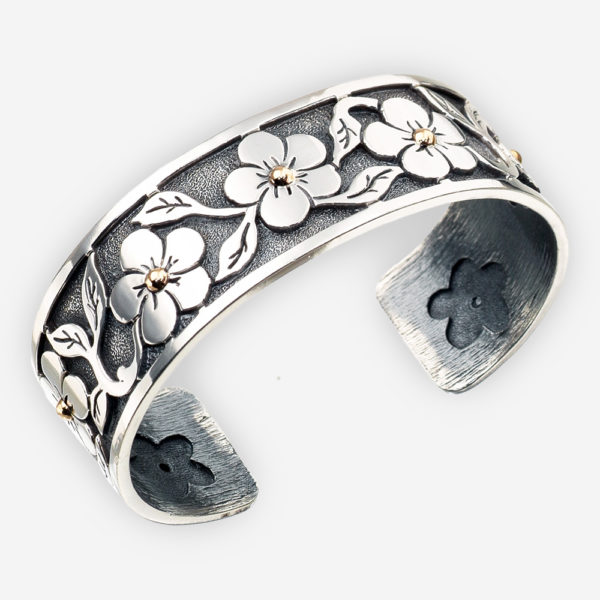Southwestern floral silver cuff featuring flowers with 14k gold pistils.