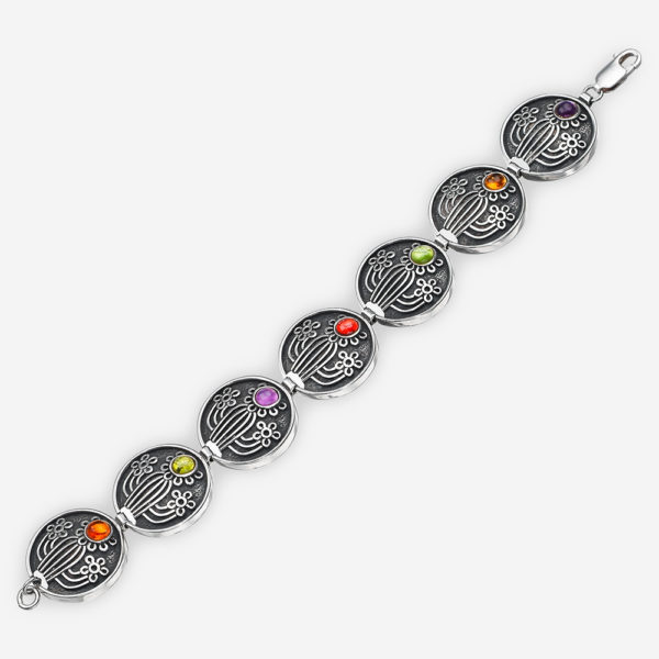 Southwestern silver bracelet with cactus and flower motifs and set with citrine, garnet, amethyst, and peridot.