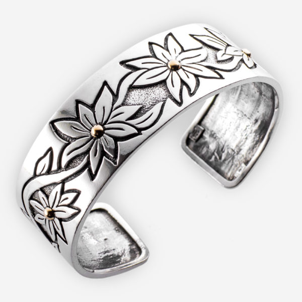 Southwestern silver flower cuff crafted in oxidized 925 sterling silver with 14k gold accents.