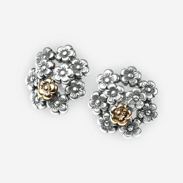 Statement floral stud earrings in sterling silver with a 14k gold flower and push back backings.