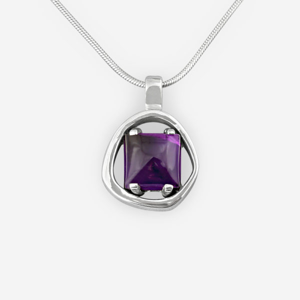 Sterling silver amethyst cabochon pendant with a high polished finish.