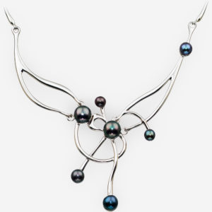 Sterling silver asymmetrical pearl necklace featuring black freshwater pearls and a high polished finish.