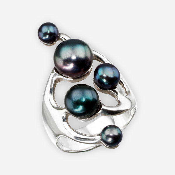 Sterling silver asymmetrical pearl ring with a polished finish and set with multiple black freshwater pearls.