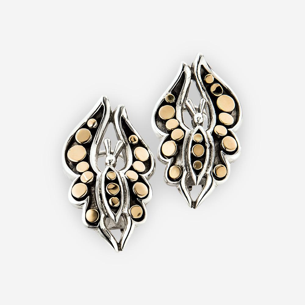 Aretes extravagantes en forma de mariposas están hechos de plata .925 y con detalles de oro de 14k.