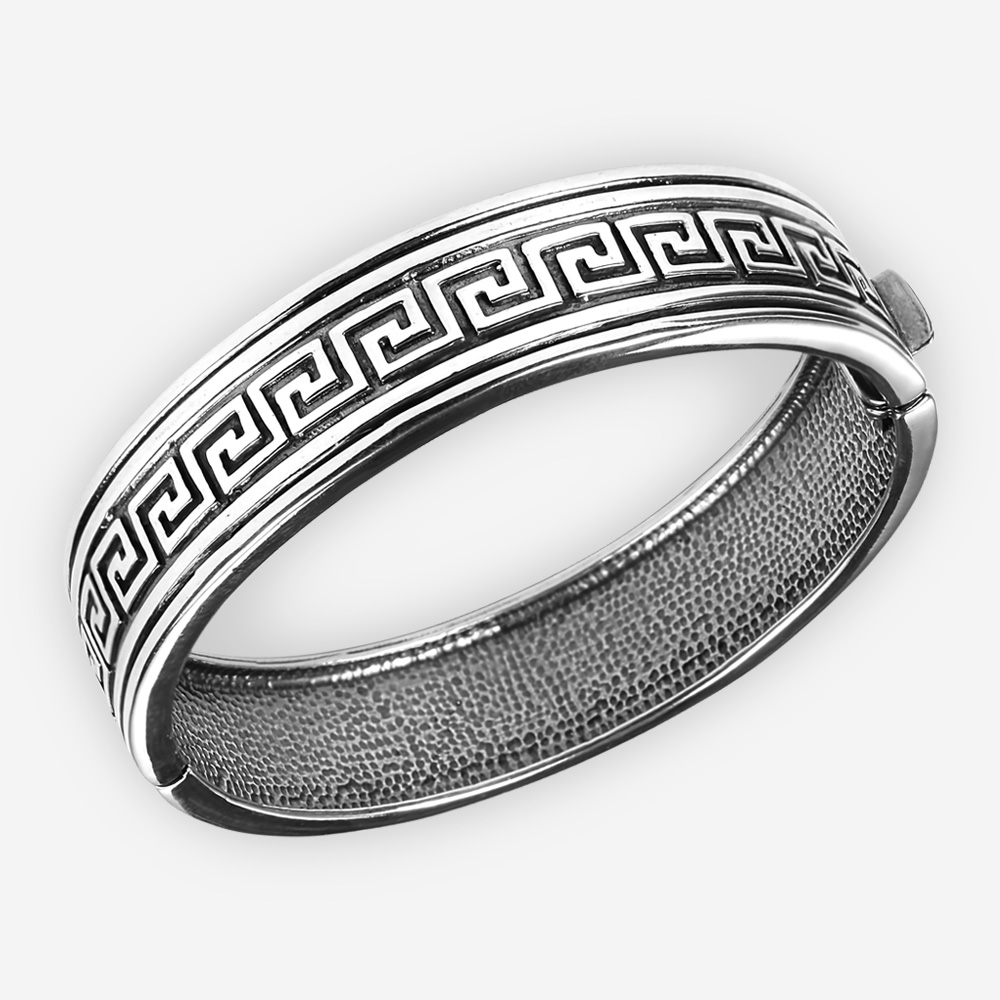 Sterling silver byzantine bangle with oxidized byzantine design and hidden closure.