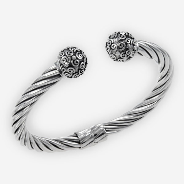 Sterling Silver Cable Bracelet with Scroll work caps and Hinge Closure.