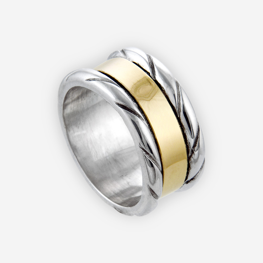 Sterling silver carved ring centered with 14k gold band.