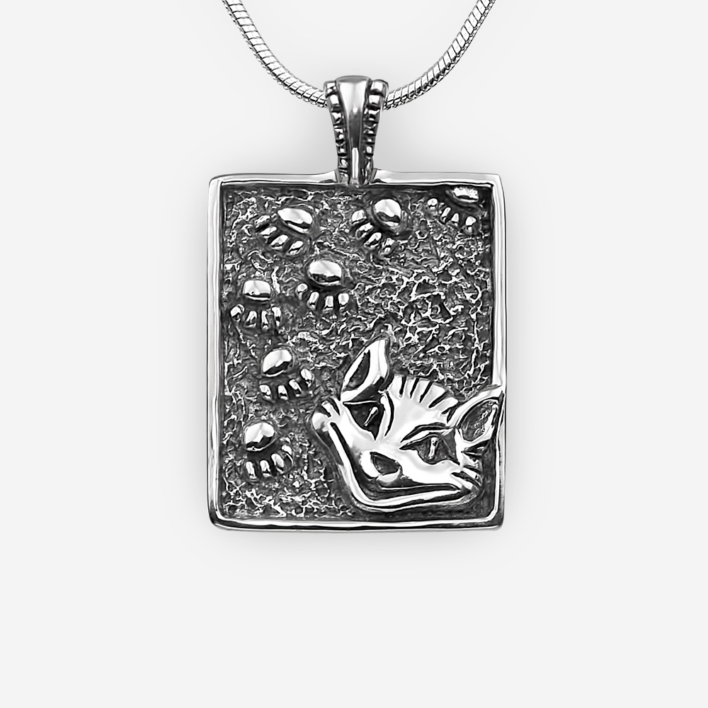 Sterling silver Cheshire Cat pendant with an oxidized finish.