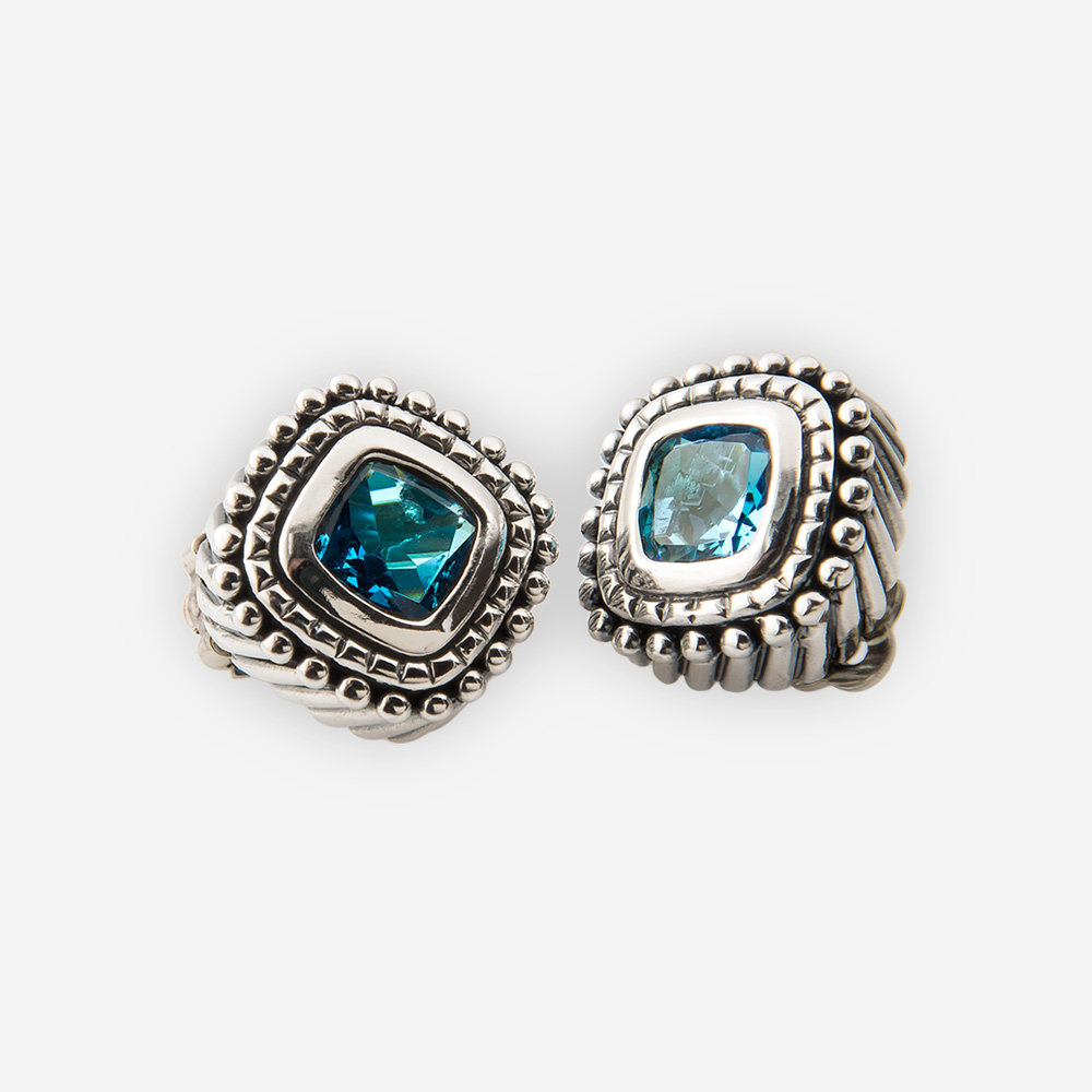 Sterling Silver Clip Earrings With Ornate Carved Details And Set A Faceted Blue Cubic Zirconia