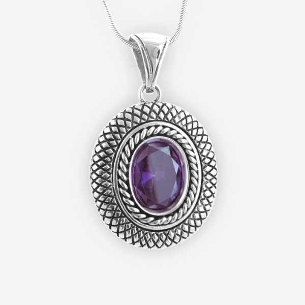 Cookie Pendant Casting in Sterling Silver with Faceted Cubic Zirconia Set. Carved with a Snake Skin Patterns.