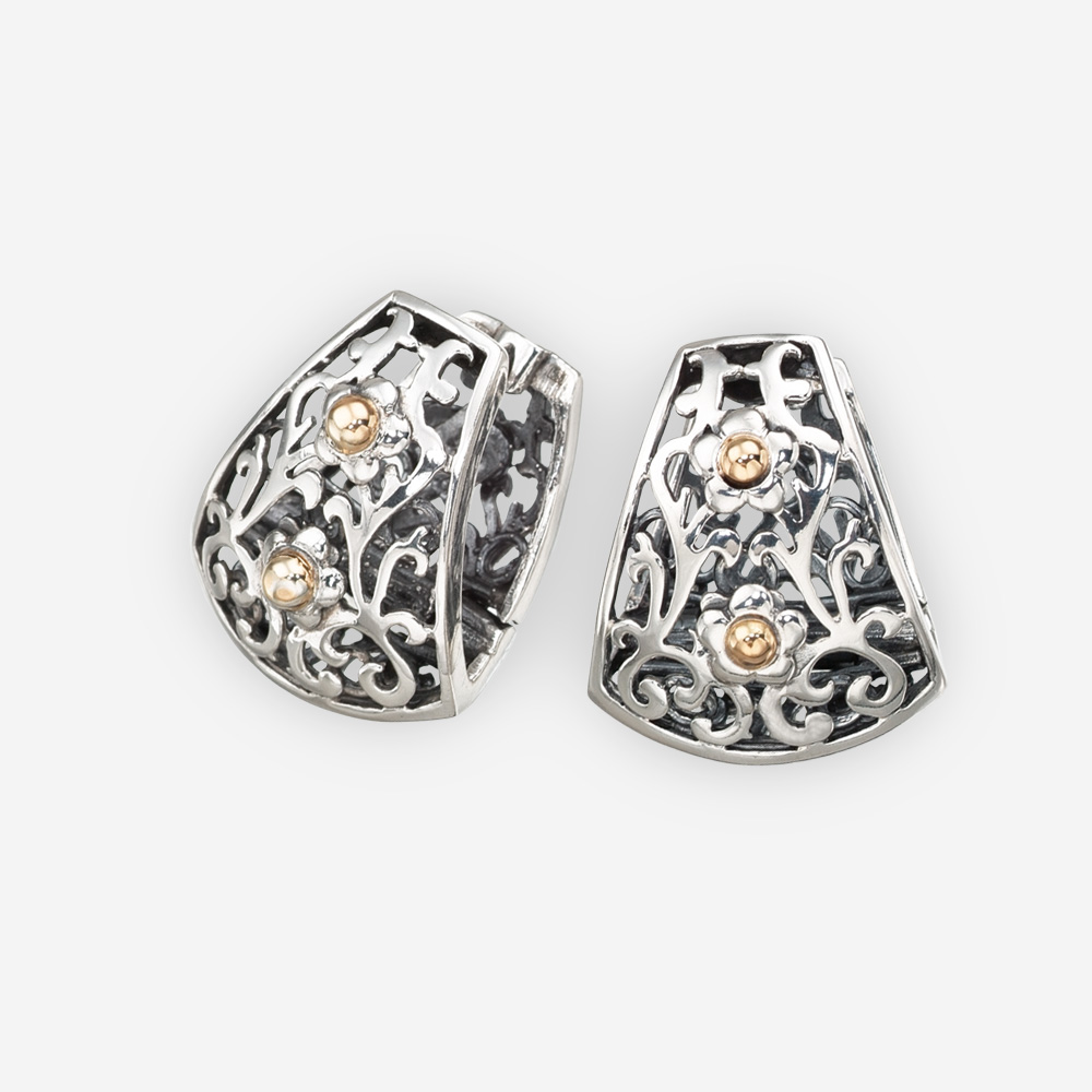 Silver cutout huggies crafted in 925 sterling silver with 14k gold flower accents.