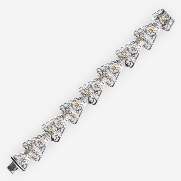 Silver cutout link bracelet crafted in 925 sterling silver with 14k gold accents.