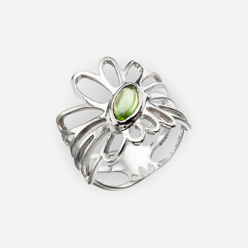 Sterling silver daisy ring set with a peridot cabochon.
