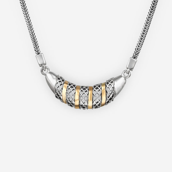 Sterling silver diamond pattern cutout necklace with 14k gold accents on a silver chain.