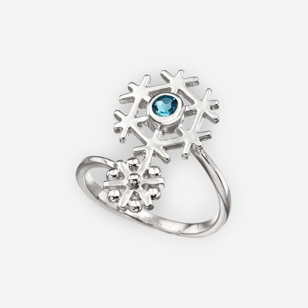 Sterling silver double snowflake ring set with a single blue topaz.