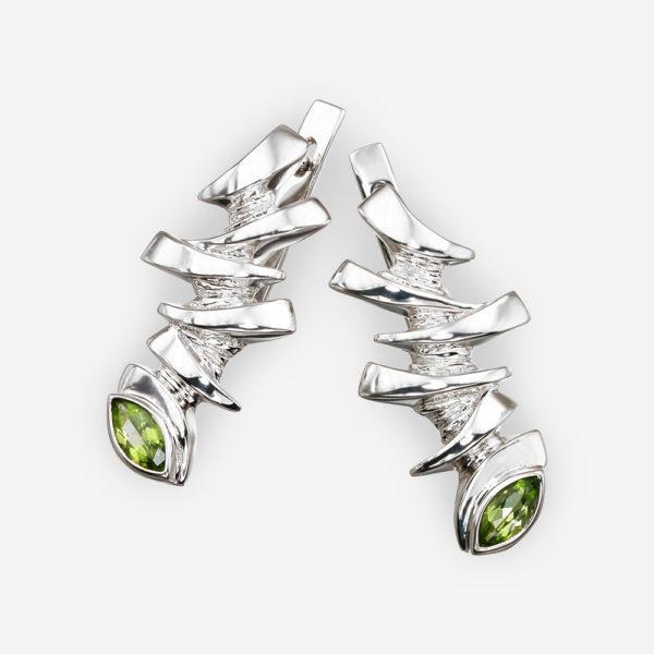 Sterling silver dragon eye earrings with peridot gems.