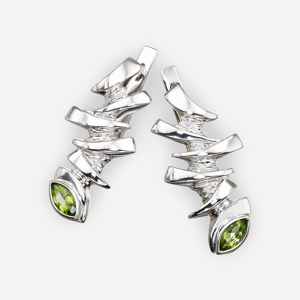Sterling silver dragon eye earrings with peridot gems.