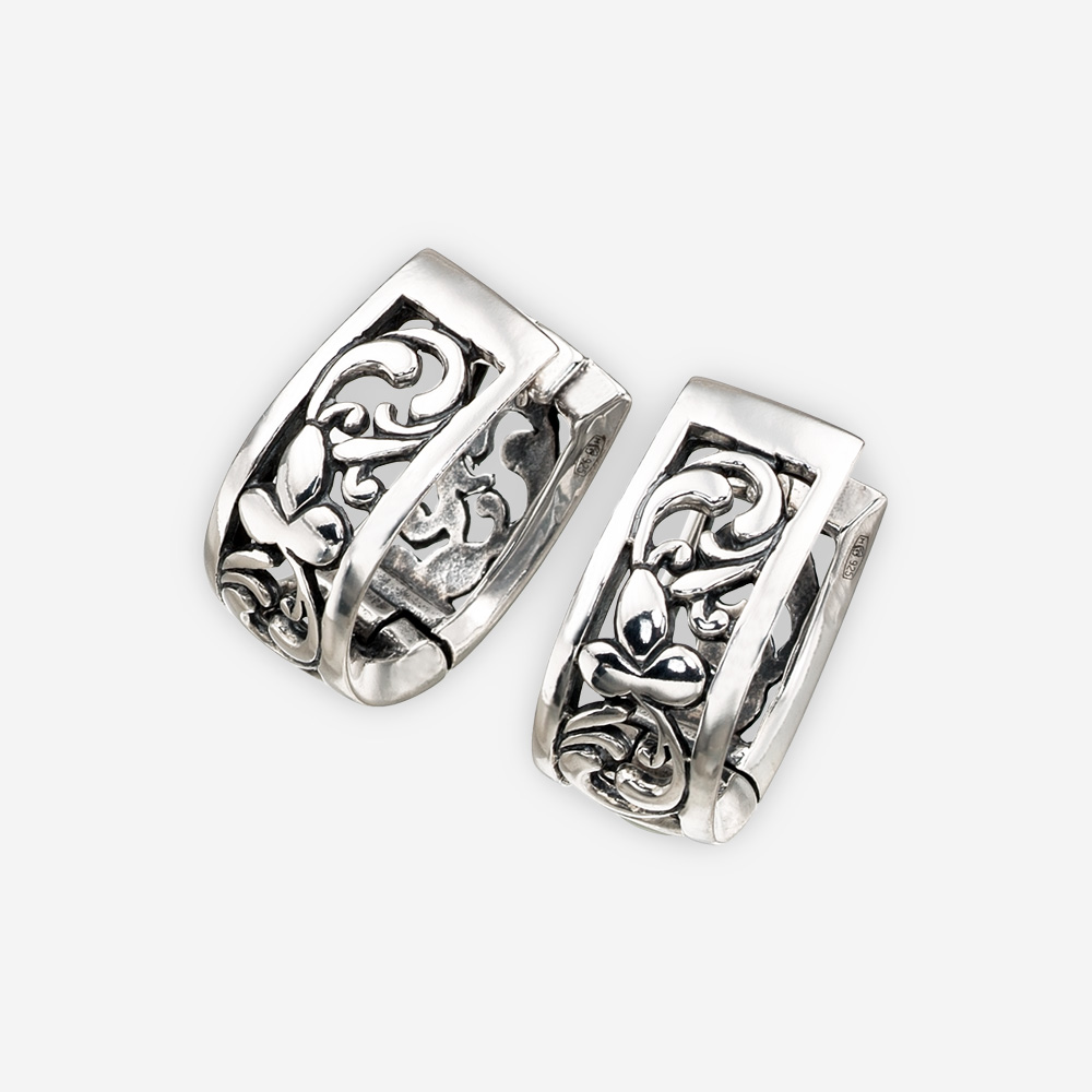 Sterling silver floral filigree earrings with a sterling silver embossed leaf accent detail.