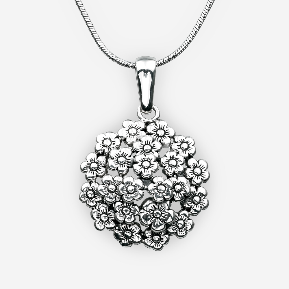 Sterling silver floral pendant with an oxidized silver finish.