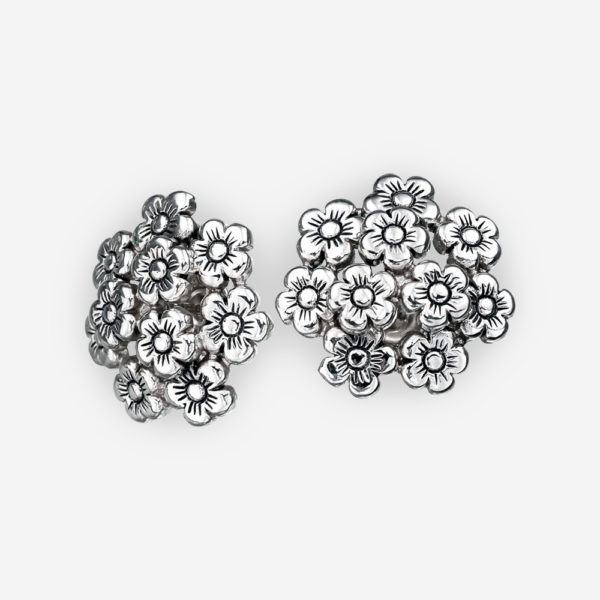Sterling silver floral stud earrings with push back backing.