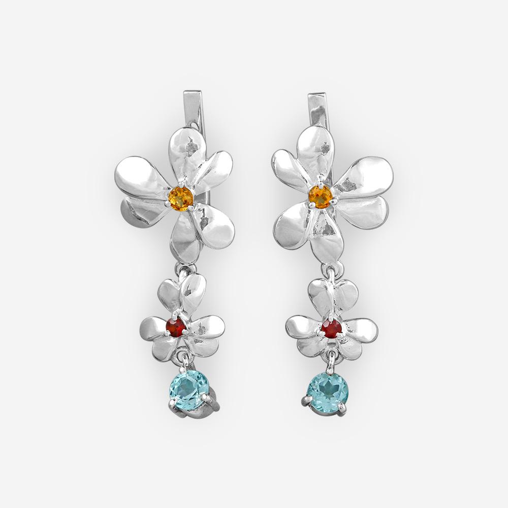 Aretes de plata en forma de flores con citrina, granate y topacio azul.