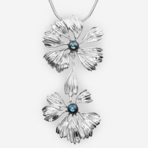 Sterling silver flower pendant set with black freshwater pearls.
