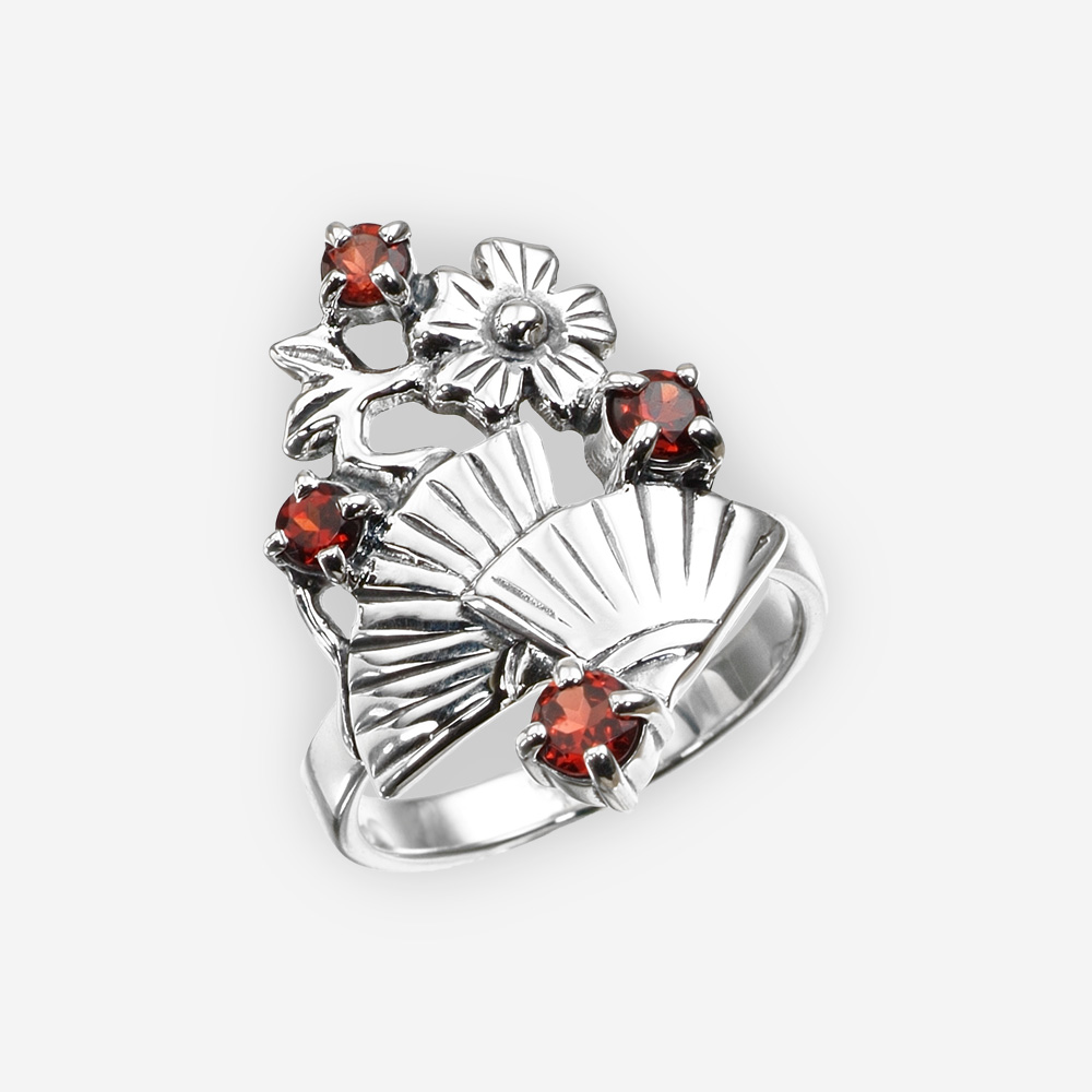 Sterling silver garnet ring with fans with a high polished finish.