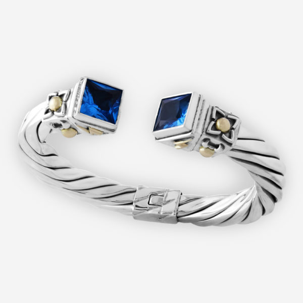 Thick hinged cable bracelet with cubic zirconia stones at each end. 925 sterling silver and 14k gold accents.
