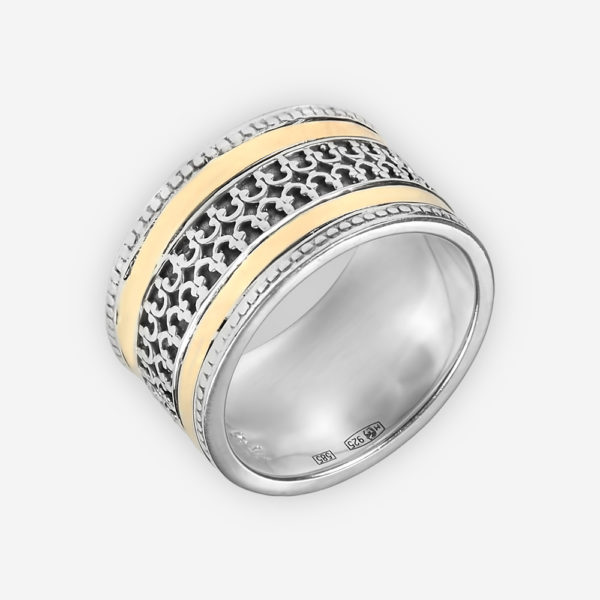 Sterling silver intricate cutout design band accented with 14k gold.