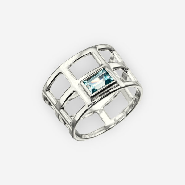 Sterling silver mesh ring set with a rectangular blue topaz gemstone.