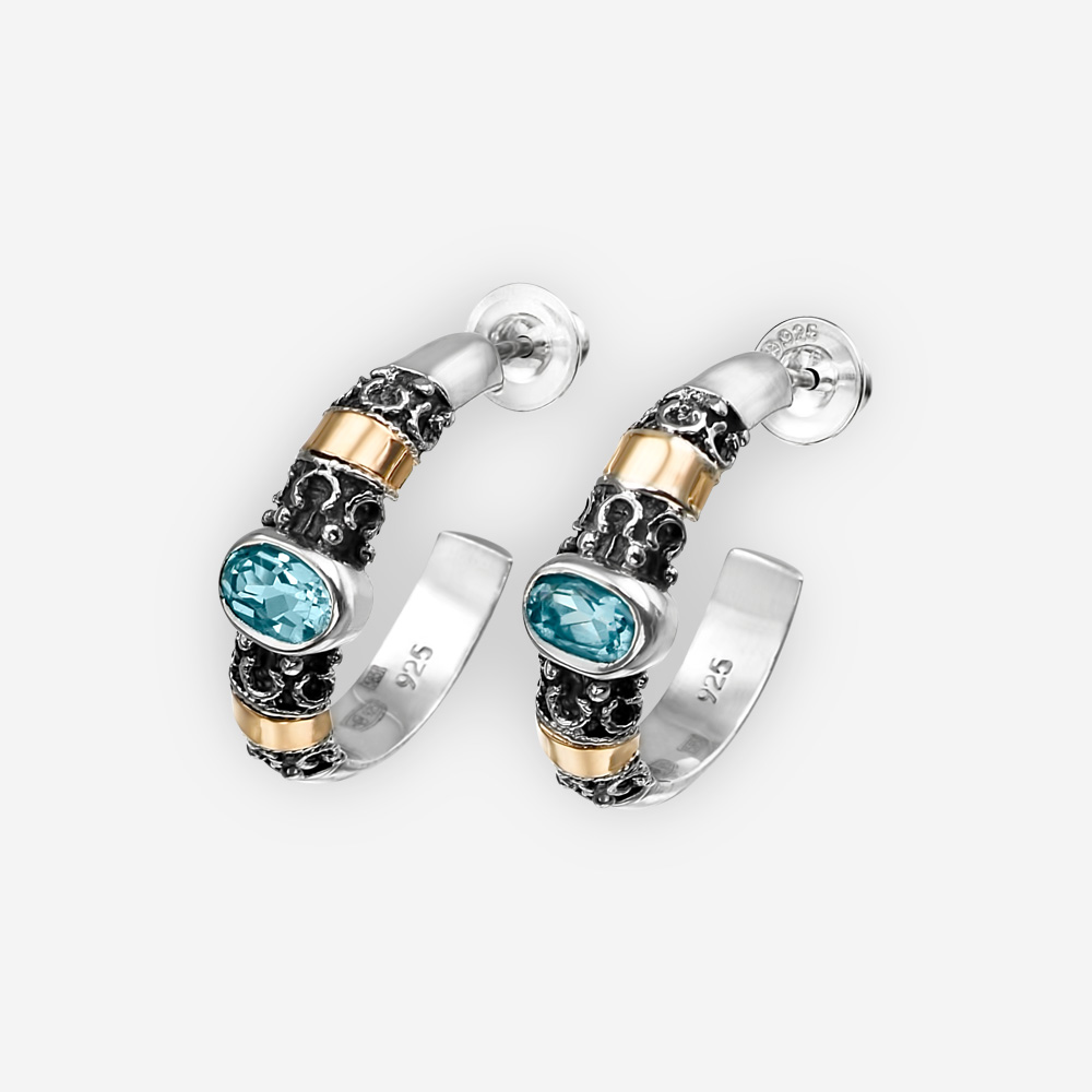Sterling silver hoop earrings crafted from 925 sterling silver and 14k gold with faceted gemstones.
