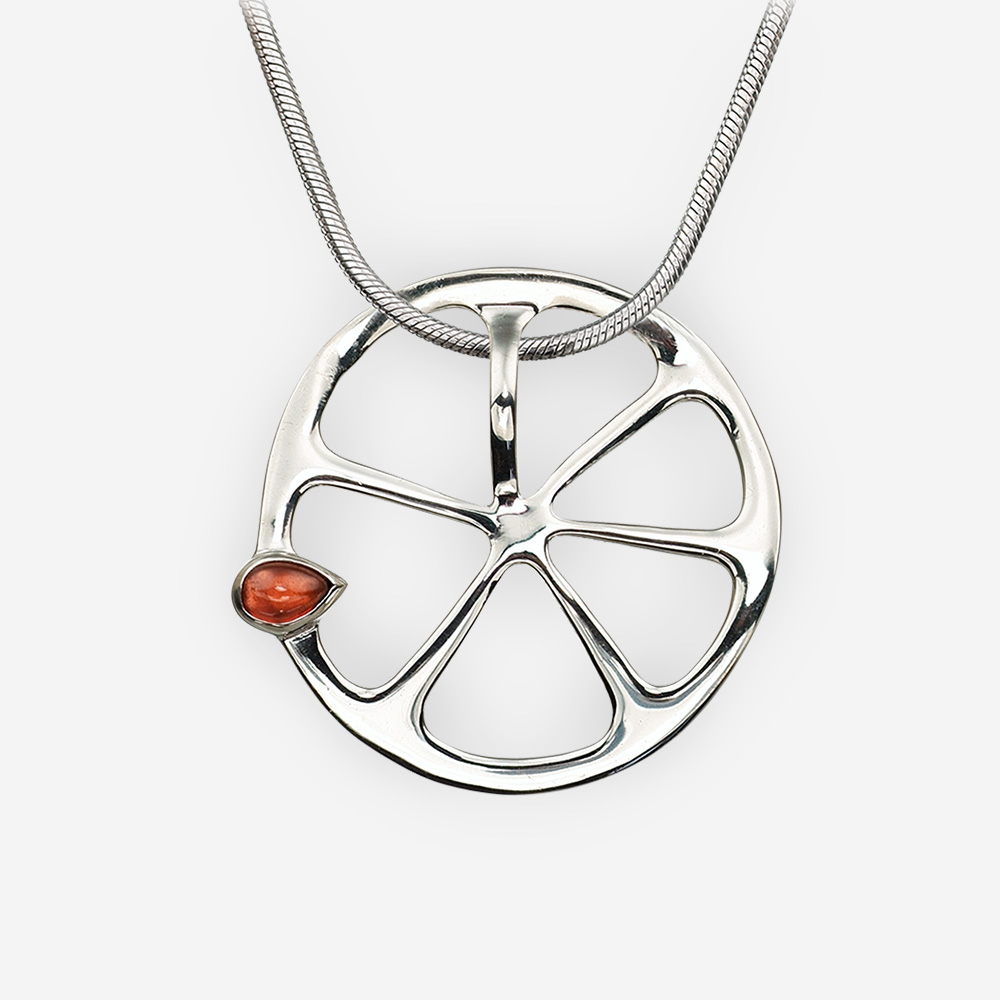 Sterling silver orange pendant with a garnet seed, crafted from 925 sterling silver.