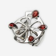 Sterling silver orange ring with a 3D design of a orange segments with four garnet seeds
