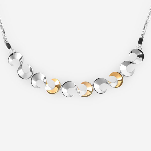 """Polished sterling silver """"S"""" link necklace with 14k gold accents on a silver woven chain."""