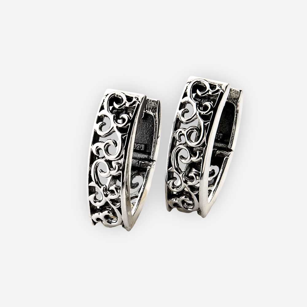 Sterling silver scrolling ivy filigree pointed hoops are crafted in 925 sterling silver with huggie closures.