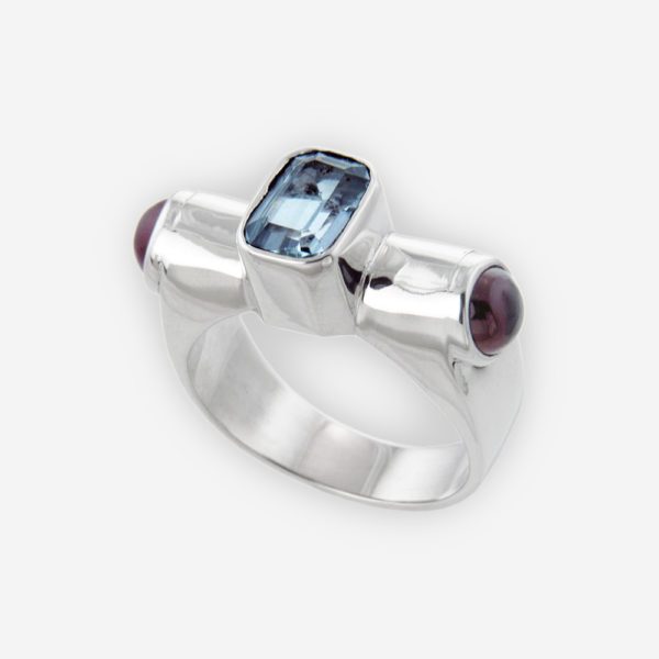 Sculptural Ring Cast in Sterling Silver Setting with Blue Topaz and Amethyst Cabujones.