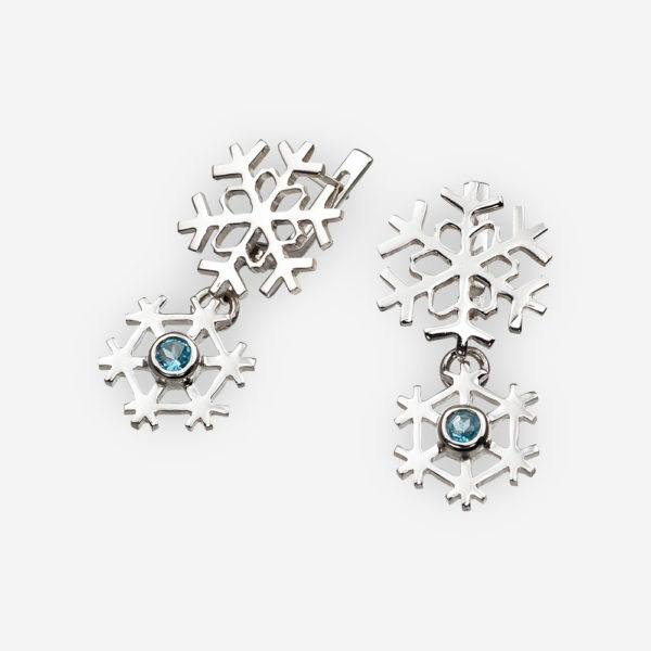 Sterling silver snowflake earrings set with blue topaz and latch back closures.