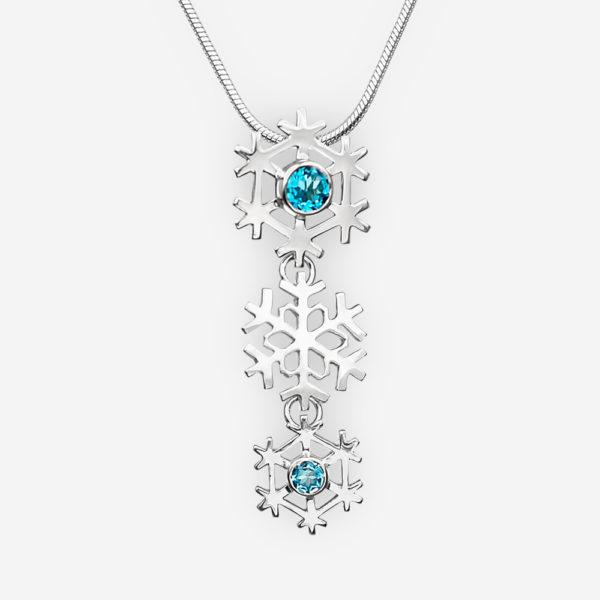 Sterling silver snowflake pendant set with blue topaz gemstones.