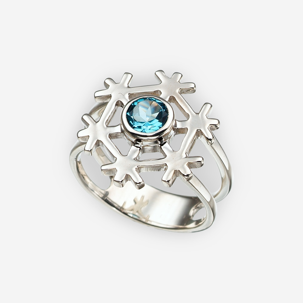 Sterling silver snowflake ring set with a blue topaz gemstone in the center of the snowflake.