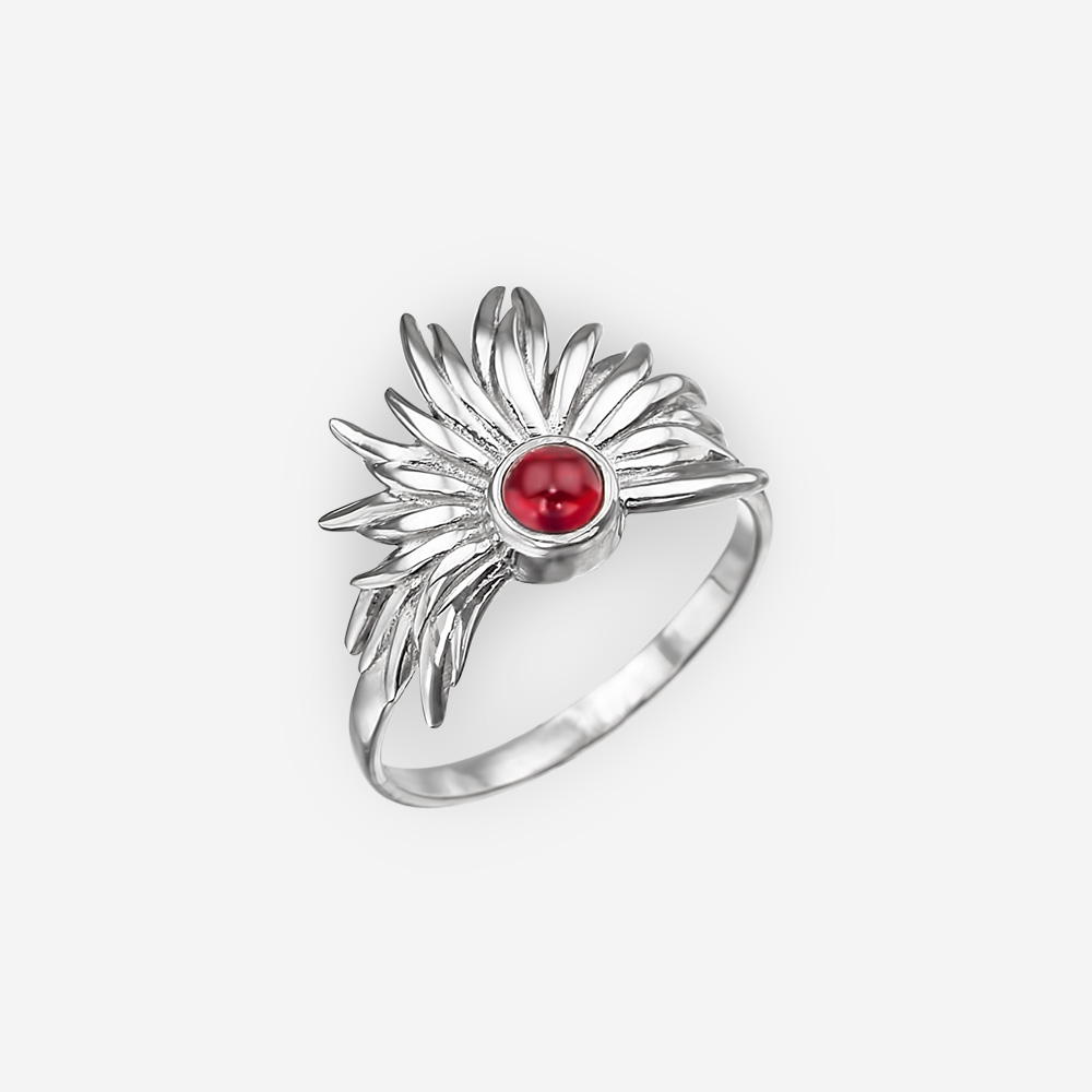 Sterling silver tribal garnet ring with a high polished finish.