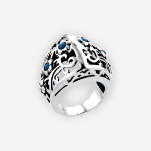 Sterling silver turquoisee flower cutout ring is crafted from polished 925 sterling silver and set with tiny turquoisee cabochons.