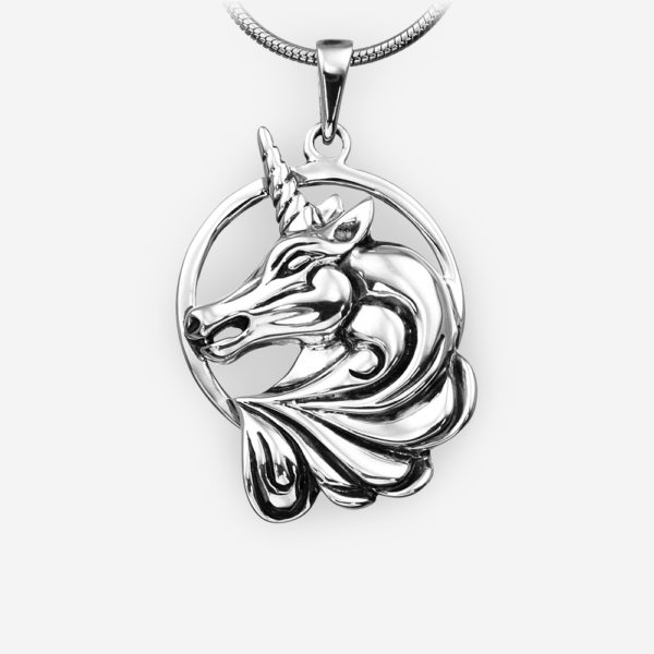 Sterling silver unicorn pendant with an oxidized finish.