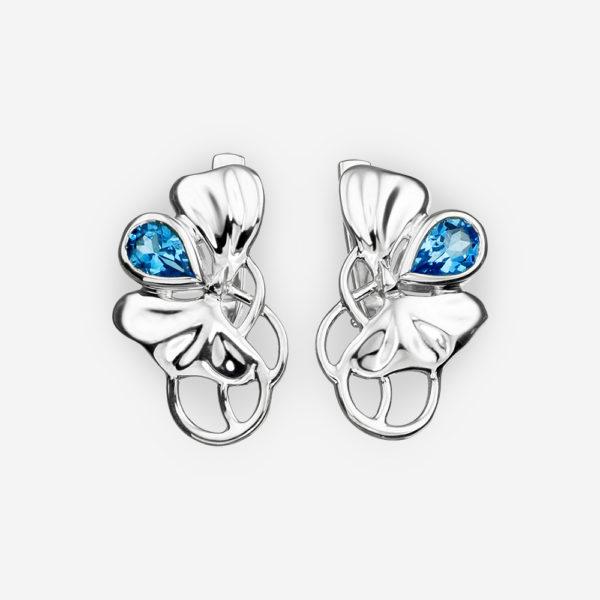 Sterling silver violet earrings set with blue topaz gemstones.
