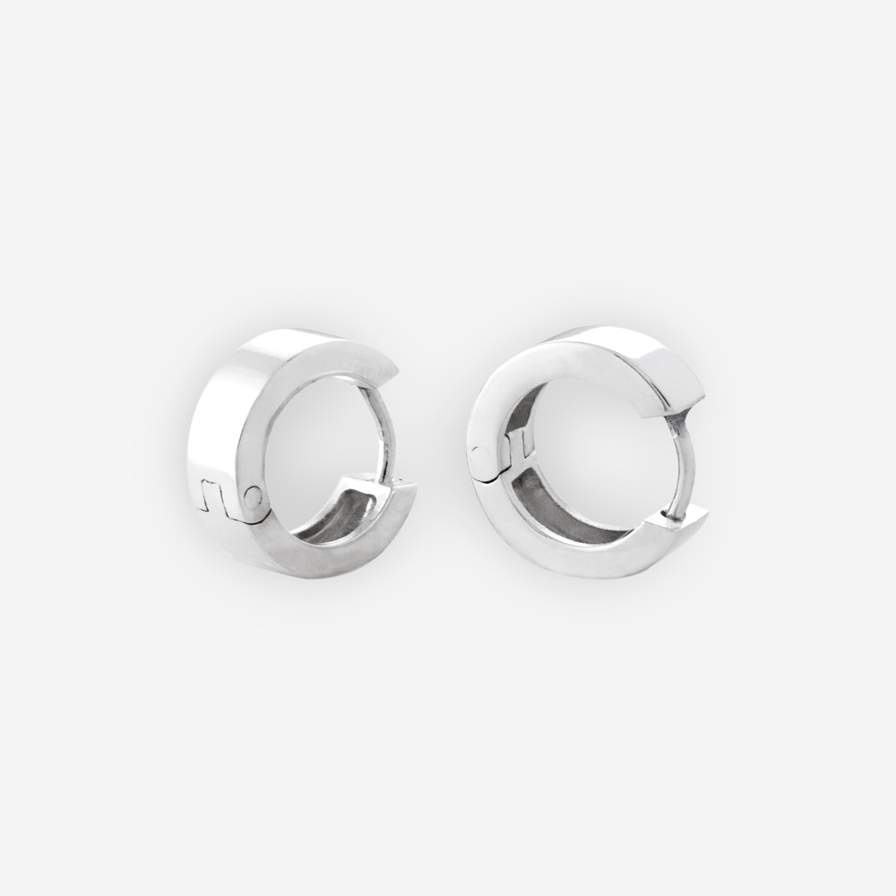 Thin sterling silver hinged hoop earrings feature huggie closures and polished 925 sterling silver.