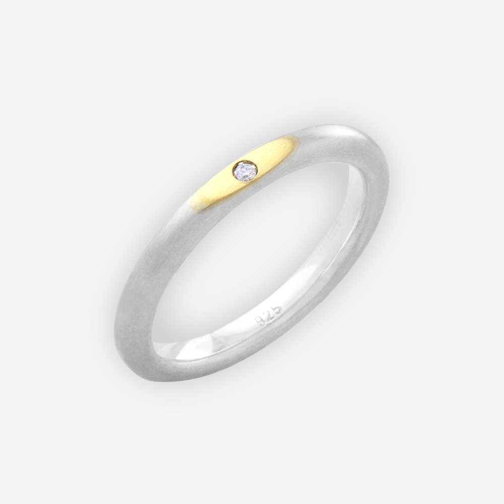 Thin two tone silver unisex ring with 14k gold upper set with CZ stone.