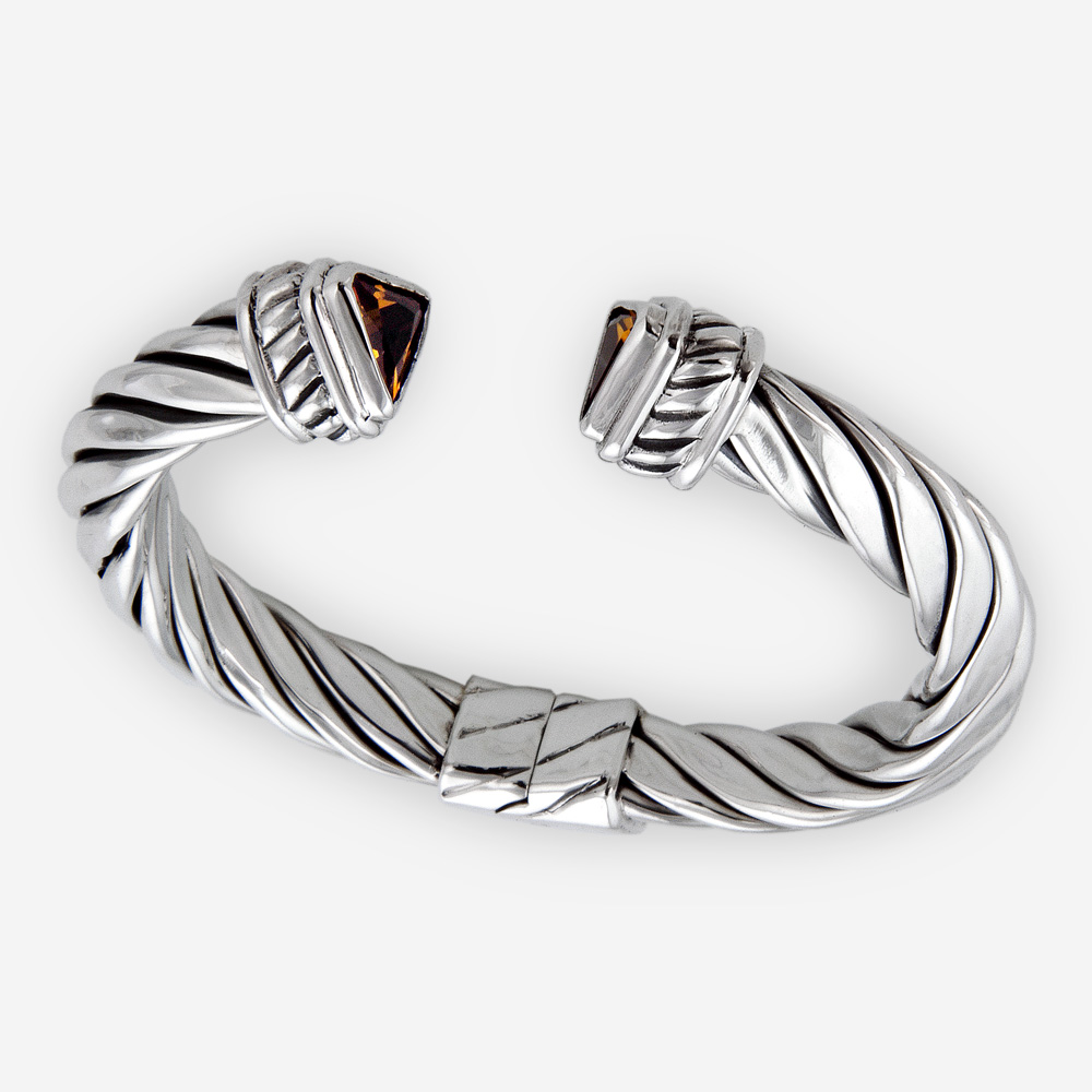 Triangular gemstone twisted cable bracelet is crafted from 925 sterling silver with CZ stones.