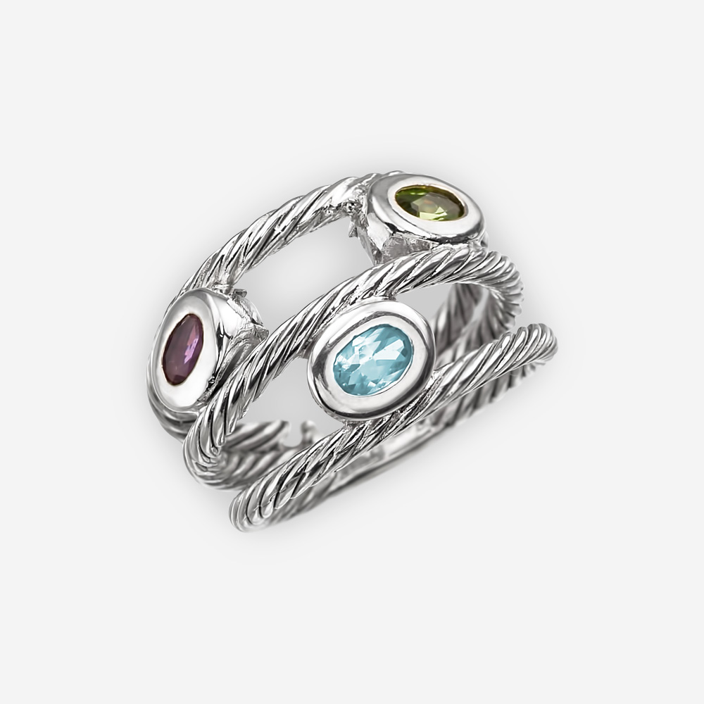 Twisted cable silver ring with triple layered bands and oval amethyst, blue topaz, and peridot gems.