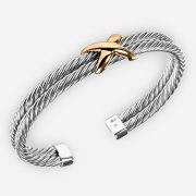 Sterling silver two tone cable cuff with twisted cable design and 14k gold focal piece.